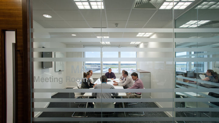 The meeting room of Manchester Airport Olympic House illuminated by Philips led office lighting.