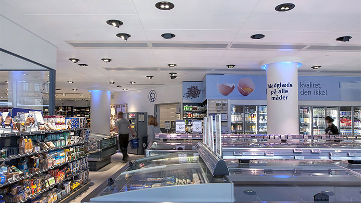 Products on display at Irma, Copenhagen lit by Philips energy saving lighting for supermarket