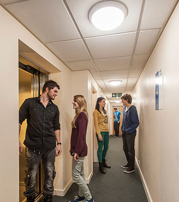 The corridor in Unite occupied with people