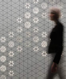 Woman walks past an interior wall decorated with Philips Luminous Patterns - customer experience